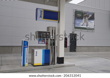 KAMPEN,THE NETHERLAND - MAR 1,  2014 :TinQpetrol station  on the back ground behind a relame poster with a dog on mar 1 , 2014 in Kampen, the netherlands.