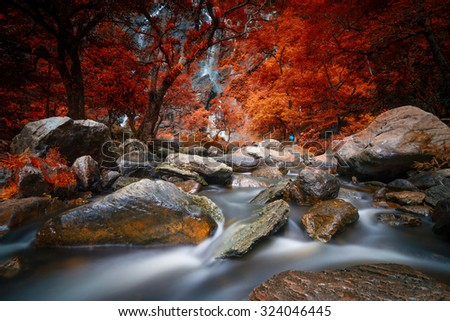 Kamphaeng Phet, Khlong Lan waterfall  in autumn forest,  - stock photo