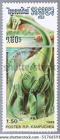 KAMPUCHEA - CIRCA 1986: A stamp printed in Kampuchea shows Brachiosaurus, series devoted to prehistoric animals, circa 1986 - stock photo