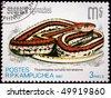 KAMPUCHEA - CIRCA 1987: A stamp printed in Kampuchea shows San Francisco garter snake - Thamnophis sirtalis tetrataenia, circa 1987 - stock photo