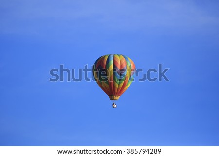 Kanab, UT, USA - February 20, 2016: A hot air balloon floats over Kanab Utah during the Balloons and Tunes celebration.
