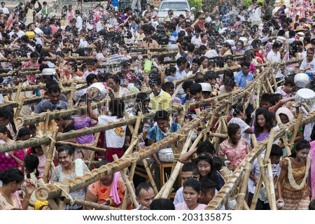 KANCHANABURI ,THAILAND - APRIL 17:The unidentified people pour the water into the bamboo rails to water a monk in Songkran festival on April 17, 2014 in Sangkhla Buri, Kanchanaburi , Thailand.