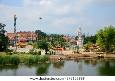 KANCHANABURI, THAILAND - DECEMBER 3 : Chinese Temple with Guan Yin statue at riverside of of the River Kwai on December 3, 2015 in Kanchanaburi, Thailand.