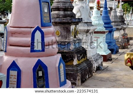 KANCHANABURI, THAILAND - December 23, 2010:   Rows of traditional Chinese tombstone Chedis at the Kanchanaburi Chinese Cemetery - stock photo