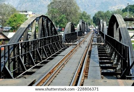 KANCHANABURI, THAILAND - December 24, 2010:  View along the tracks of the legendary railway Bridge on the River Kwai immortalized in the classic 1957 David Lean movie - stock photo