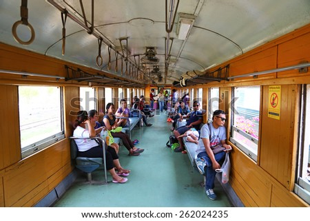 KANCHANABURI,THAILAND - MARCH 14,2015 : People on a train in Kanchanaburi province, Thailand on Aug 25, 2013. This railway was built by Japan in 1943, to support its forces in World War II. - stock photo