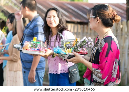 KANCHANABURI THAILAND - MAY 17 : Tourists and locals give alms food to monks during the morning on May 17,2015 in KANCHANABURI,THAILAND