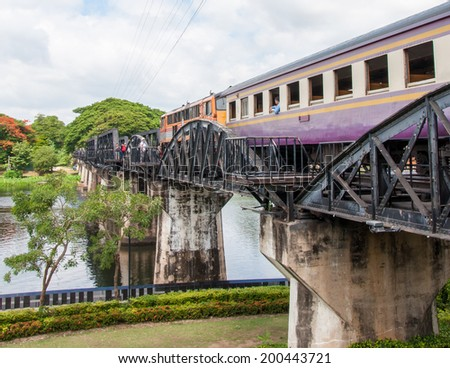 "Kanchanaburi, Thailand - May 23, 2014: Train on the bridge over river Kwai in Kanchanaburi province, Thailand.The bridge is famous due to the movie ""The Bridge on the River Kwai"". - stock photo"