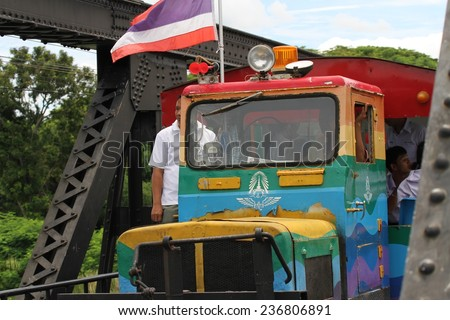 KANCHANABURI, THAILAND - SEPTEMBER 4: Tourists and school children on the colorful tourist train on the Bridge over the River Kwai, Kanchanaburi, Thailand taken on the 4th September, 2014.