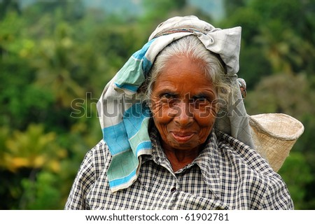 KANDY, SRI LANKA - DECEMBER 4: Portrait of aged Tamil tea picker December 4, 2008 in Kandy, Sri Lanka. During 2008, the government forces started attacking Tamil militants in the north of Sri Lanka. - stock photo
