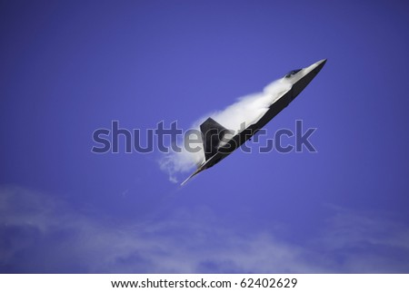 KANEOHE, HI - SEPTEMBER 26:  An F-22 Raptor of the U.S. Air Force demonstrates its capabilities on September 26, 2010 at the Kaneohe Bay Airshow in Hawaii