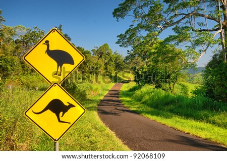 Kangaroo and Cassowary warning sign at a lonely country road in the Atherton Tablelands, Queensland, Australia - stock photo