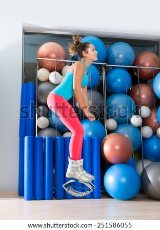 Kangaroo jumps anti gravity fitness boots girl at gym indoor - stock photo