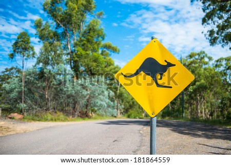 Kangaroo warning sign on a road. - stock photo