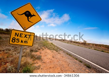 Kangaroo warning sign on a road in the Australian outback.  Western New South Wales. - stock photo