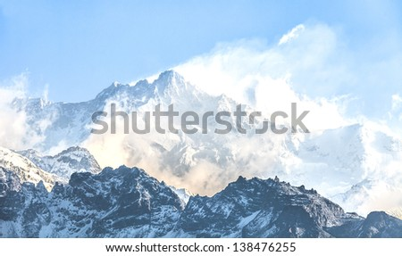 Kangchenjunga is the third highest mountain in the world. It rises with an elevation of 8,586 m : From Dzongri View Point - stock photo