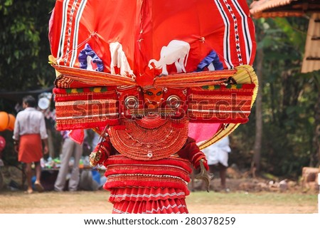Kannur - 3/30/2015: A Theyyam artist performing during the festival at  Arathil Bhagavathi Temple on March 20, 2015 in Kannur. Theyyam  is a ritualistic folk art form of North malabar in Kerala.
