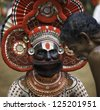 KANNUR, INDIA - DECEMBER 11, 2011: A traditional Theyyam religious performer gives advice to a lay devotee during the annual performance of Theyyam on December 11, 2011 near Kannur, India. - stock photo