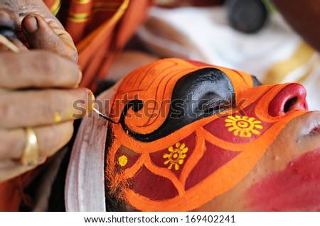 KANNUR, INDIA - NOVEMBER 28, 2011: Actor prepares for Theyyam Performance on November 28, 2011 in Kannur (Kerala/ India). Theyyam is a Hindu ritual form of North Malabar in Kerala, India. - stock photo