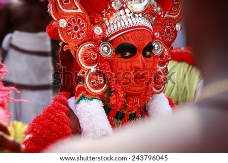 KANNUR - JAN 05: A Theyyam performer gives blessings to a devotee during the annual festival held at Kadannappalli Muchilot Bhagavati temple on January 05, 2015 in Kannur, IndiaIndia - stock photo