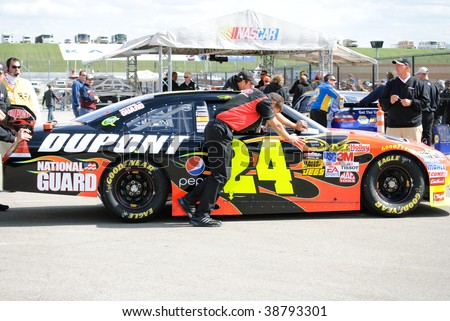 KANSAS CITY, KS - OCT 2:  Nascar driver Jeff Gordon's car is pushed in line for inspection at Kansas Speedway on qualifying day on October 2, 2009 in Kansas City, KS. - stock photo