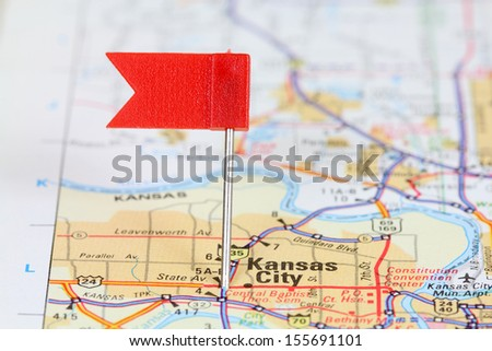Kansas City, Missouri. Red flag pin on an old map showing travel destination.