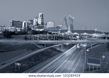 Kansas City. Toned image of the Kansas City skyline and busy highway system leading to the city. - stock photo