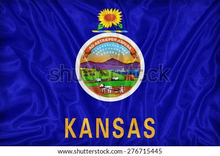 Kansas flag pattern on fabric texture,retro vintage style - stock photo