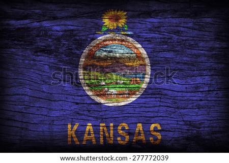 Kansas flag pattern on wooden board texture ,retro vintage style - stock photo