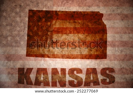 kansas map on a vintage american flag background - stock photo