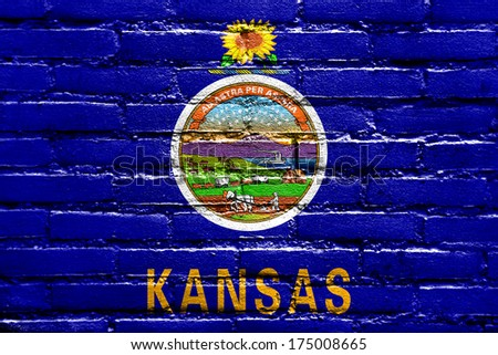Kansas State Flag painted on brick wall - stock photo