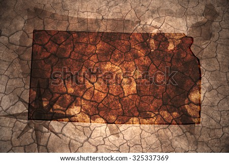 Kansas state map on vintage usa map, crack paper background - stock photo