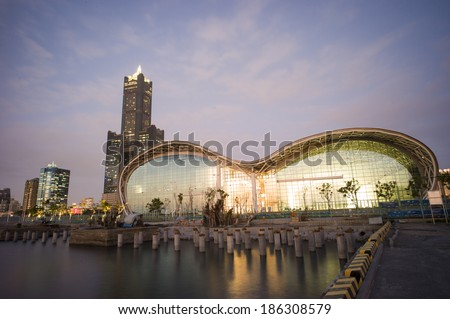 KAOHSIUNG CITY, TAIWAN - FEB 17: Tuntex Sky Tower and the expo at dusk in Kaohsiung, Taiwan February 17 2014. It is the second tallest building in Taiwan. - stock photo
