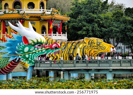 KAOHSIUNG CITY, TAIWAN - JAN 18, 2015: Local with Chinese-style architectural interest - Dragon Tiger Tower, Jan 18, 2015 in Kaohsiung - Taiwan, the daily influx of so many tourists come to play. - stock photo