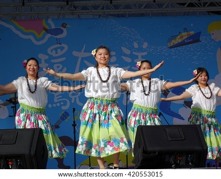KAOHSIUNG, TAIWAN -- APRIL 23, 2016: A group of unidentified dancers performs a Hawaiian dance at the 1st Pacific Rim Ukulele Festival, a free, public outdoor event.