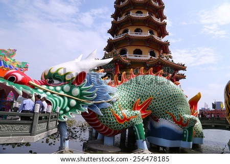 Kaohsiung - Taiwan, February 22, 2015: Local and Chinese-style architectural features - Dragon and Tiger Pagodas, the influx of so many visitors come to play every day.