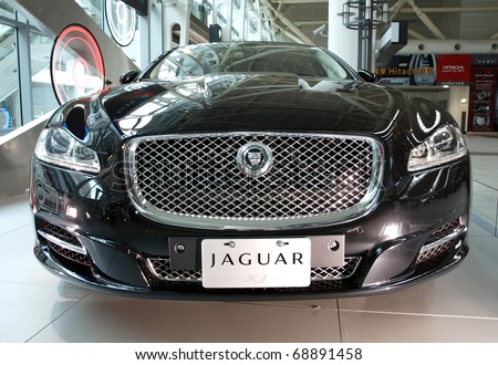 KAOHSIUNG, TAIWAN - JANUARY 13: Jaguar International introduces its all new Jaguar XJ luxury sedan in the main hall of the Taiwan High Speed Railway Corporation; Kaohsiung, January 13, 2011 - stock photo