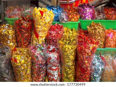 KAOHSIUNG, TAIWAN -- JANUARY 28, 2014: Large sacks of candy at an outdoor store. At Chinese New Year it is customary for people to have a variety of sweets on hand to offer to guests.