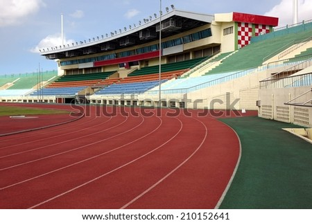 KAOHSIUNG, TAIWAN -- JULY 1, 2014: A view of the athletic running tracks and the bleachers of the Jhong Jheng Stadium in Kaohsiung city. - stock photo