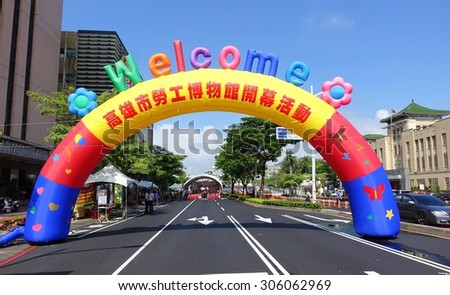 KAOHSIUNG, TAIWAN -- JULY 25, 2015: An inflatable welcome arch marks the entrance to the opening ceremony for the new Kaohsiung Museum of Labor. - stock photo