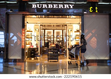 KAOHSIUNG, TAIWAN - JULY 12: Burberry shop in Kaohsiung International airport. July 12, 2014. Burberry is a British luxury fashion house distributing clothing, and accessories  founded in 1856. - stock photo