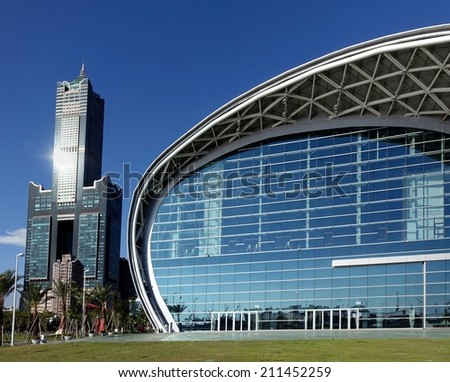 KAOHSIUNG, TAIWAN -- JULY 13, 2014:  View of the new Kaohsiung Exhibition Center and the 85 story Tuntex Tower - stock photo