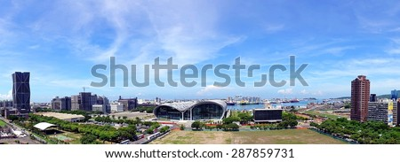 KAOHSIUNG, TAIWAN - JUNE 11, 2015: A panoramic view of Kaohsiung port with the new exhibition center in the center foreground. - stock photo