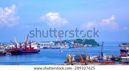 KAOHSIUNG, TAIWAN -- JUNE 11, 2015: A view of the entrance to Kaohsiung Harbor with the old Chijin lighthouse on the back.