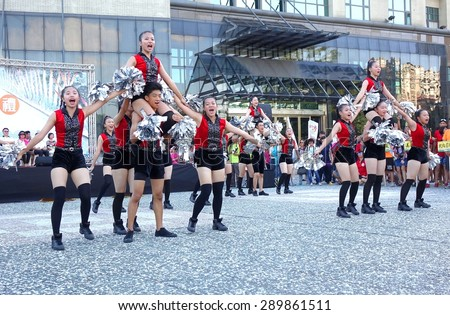 KAOHSIUNG, TAIWAN -- JUNE 17, 2015: Students from the Shu-Te High School perform a free outdoor dance for the start of the Dragon Boat Festival. - stock photo