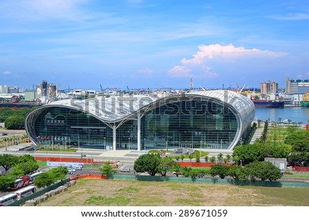 KAOHSIUNG, TAIWAN -- JUNE 11, 2015: The new Kaohsiung Exhibition Center with its characteristic waved roof. In the background you can see the large port.   - stock photo