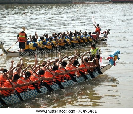 KAOHSIUNG, TAIWAN - JUNE 3: To celebrate the Duanwu Festival Kaohsiung City in Taiwan conducts Dragon Boat races on the Love River on June 3, 2011 in Kaohsiung, Taiwan.
