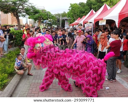 KAOHSIUNG, TAIWAN -- JUNE 20, 2015: Two young men perform a traditional lion dance during the 2015 Dragon Boat Festival activities. - stock photo
