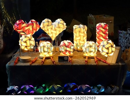 KAOHSIUNG, TAIWAN -- MARCH 6, 2015: An outdoor vendor sells handmade lanterns made from paper and wood. - stock photo