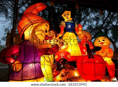 KAOHSIUNG, TAIWAN -- MARCH 6, 2015: Colorful lanterns to celebrate the year of the goat are on display along the banks of the Love River during the Lantern Festival. Here are Snowhite and the 7 Dwarfs - stock photo